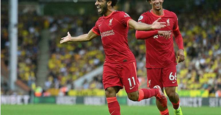 Mohamed Saleh (L) celebrates his goal for Liverpool at Norwich on the opening weekend of the English Premier League season JUSTIN TALLIS AFP
