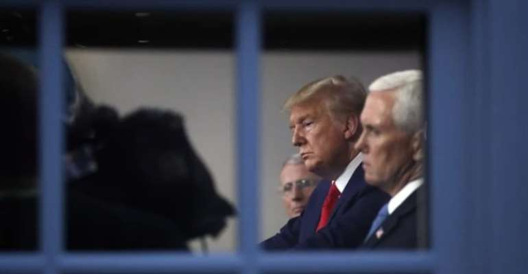 President Donald Trump and Vice President Mike Pence listen to a briefing about the coronavirus at the White House in Washington, March 31, 2020 (AP photo by Alex Brandon).