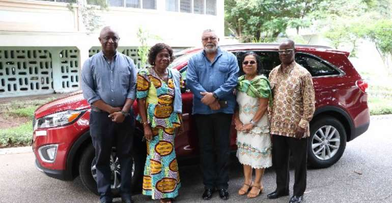 Former President Rawlings and his associates pose with Madam Pomary.