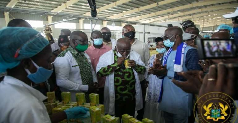 President Nana Akufo-Addo drinking Eku juice at the factory during opening ceremony