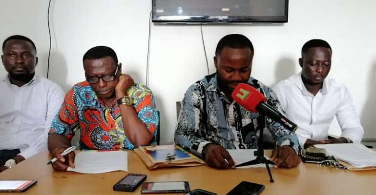 Maxwell Ofosu Boakye flanked by NPP Constituency Chairman Bright Osei Agyeman and Secretary