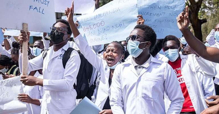 University of Nairobi medical students protest over a bid to increase tuition fees.  - Source: Photo by Patrick Meinhardt / AFP via Getty Images