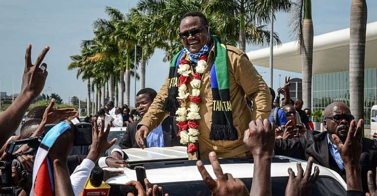 Tundu Lissu reacts to supporters as he returns home after three years in exile. - Source: