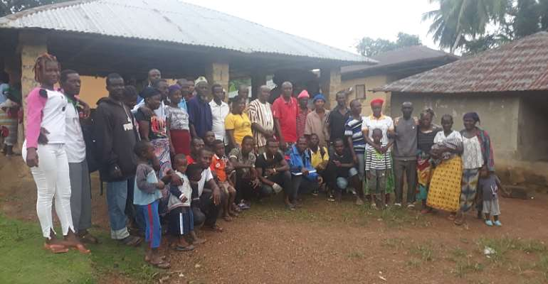 Charcoal burners with NACUL President and Supt. Moore at the meeting in Borjeh Town