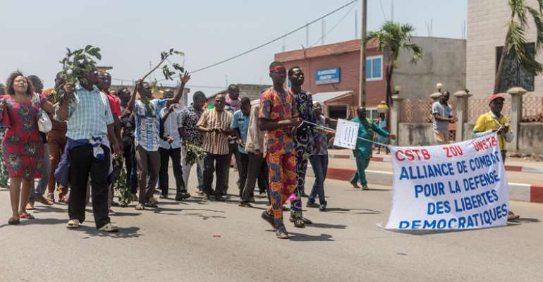 Protesters From Two Of Benin's Unions Take Part In A Demonstration After The Parliament Approved A Law Restricting To 10 Days Public Sector Employees' Right To Strike, On September 13, 2018, In Cotonou. Journalist Ignace Sossou Convicted Of False News In Benin On August 12, 2019. (AFP/Yanick Folly)