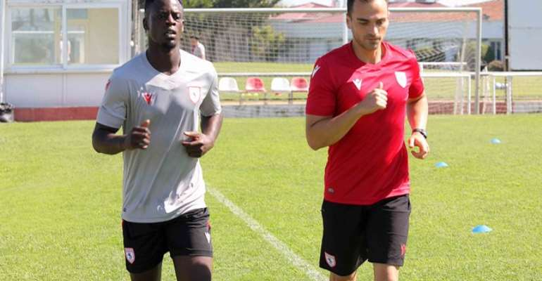 Edwin Gyasi with club official