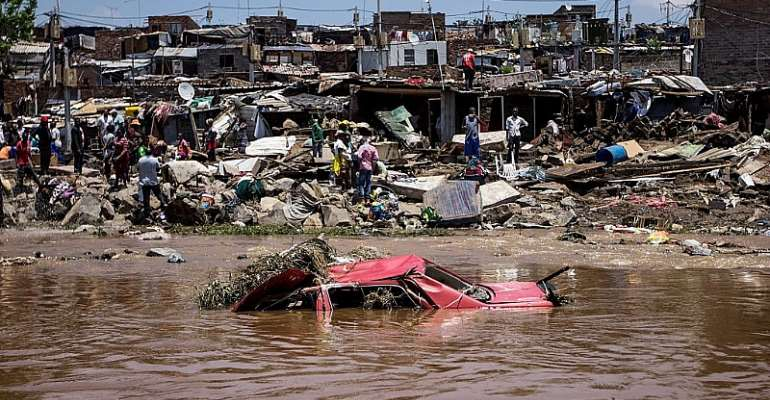 A car that was washed away floats close to the banks of the Jukskei River in Alexandra Township after floodwaters ravaged the area on November 10, 2016. - Source: Gulshan Khan/AFP via Getty Images