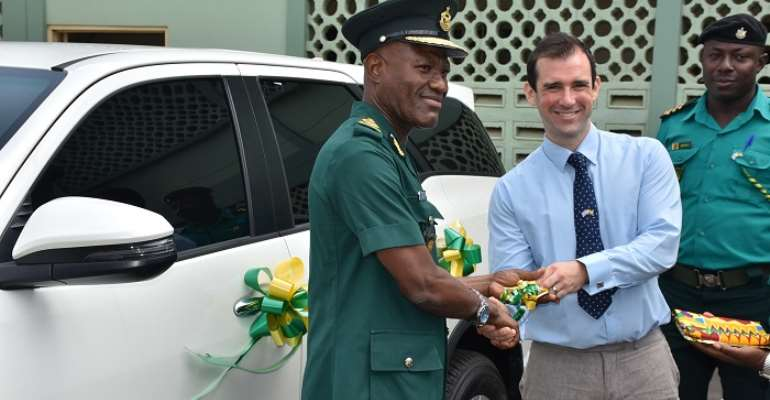 The mission's representative presenting the ignition key to the CGI