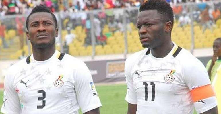 Asamoah Gyan and Sulley Muntari