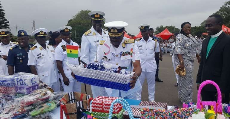 Chief Of Naval Staff, Rear Adm Seth Amoama inspecting some of the prod ucts