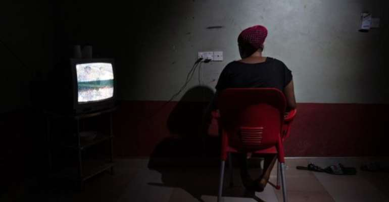 Blessing, a 26-year-old from Nigeria, inside the guesthouse where she lives with other 20 women who were also forced into prostitution [Francesco Bellina/Al Jazeera]