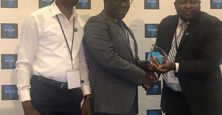 Mr Osman (middle) receiving the award Ernest Honya, President of ACCPA while Mr Asante looks on