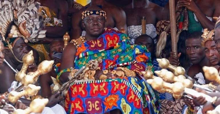 The Asanti king, Otumfuo Osei Tutu II, is seen here in a Kente at a durbar in 2018 — Getty Images