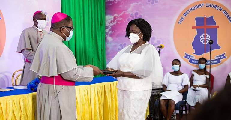 The Presiding Bishop Of The Methodist Church, Most Reverend Dr. Paul Kwabena Boafo, Presenting A Bible To The Vice Presidential Candidate