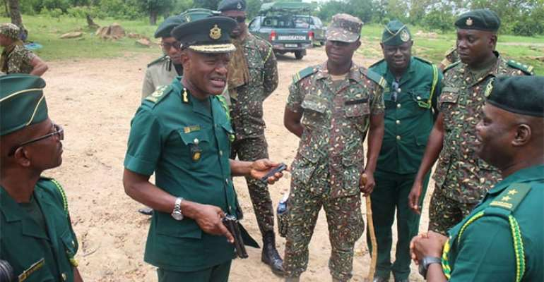 Lawyer, Kwame Asuah Takyi with GIS officers