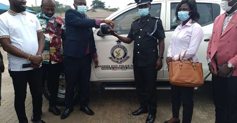 Asokwa MCE,  Chief Akwannuasah Gyimah presenting keys to the pickup vehicle to Chief Superintendent Christopher Owusu Mpianin, Asokwa District Police Command