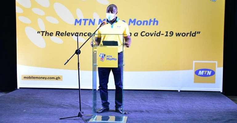 Eli Hini - GM Mobile Money Ltd delivering an address at the launch