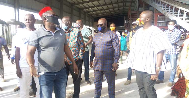 Mr. Boateng (In Red Cap) Taking The Dignitaries Round The Facility