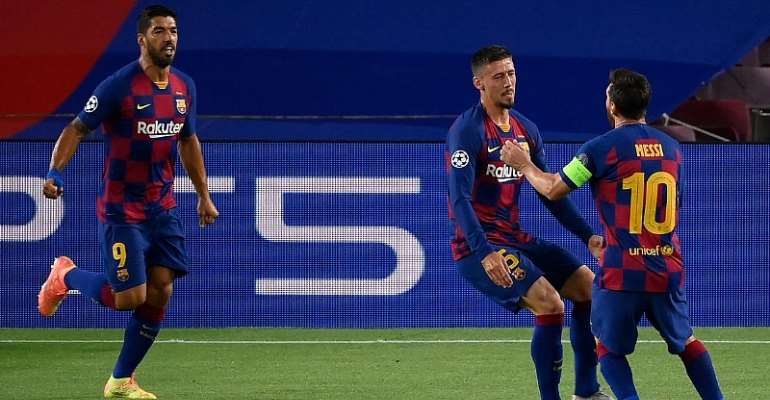 Barcelona's French defender Clement Lenglet (C) celebrates with Barcelona's Argentine forward Lionel Messi (R) and Barcelona's Uruguayan forward Luis Suarez (R) after scoring a goal during the UEFA Champions League round of 16 second leg football match be  Image credit: Getty Images