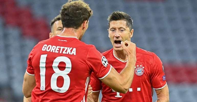 Bayern Munich's Polish forward Robert Lewandowski (R) celebrates with his teammate Bayern Munich's German midfielder Leon Goretzka after scoring his team's first goal during the UEFA Champions League, second-leg round of 16, football match FC Bayern Munic  Image credit: Getty Images