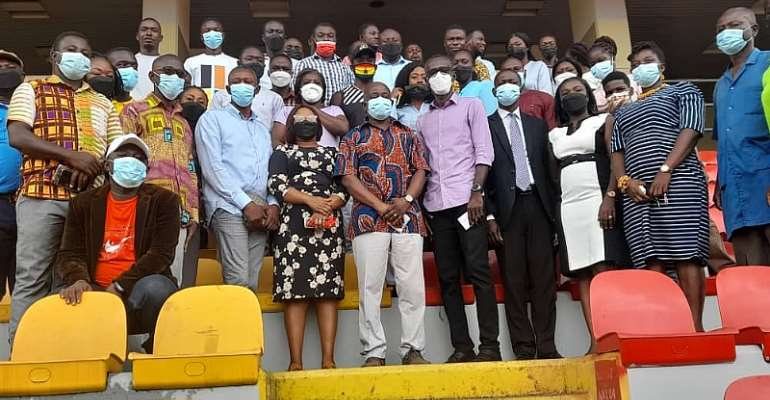 Mr. Simon Osei Mensah in a group photograph with some of the contractors and staff of the Stadium at the Baba Yara Stadium in Kumasi