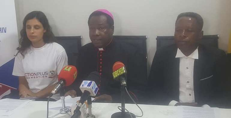 Apostle Fred Annim with Yasmin Dunkley (left) addressing the media