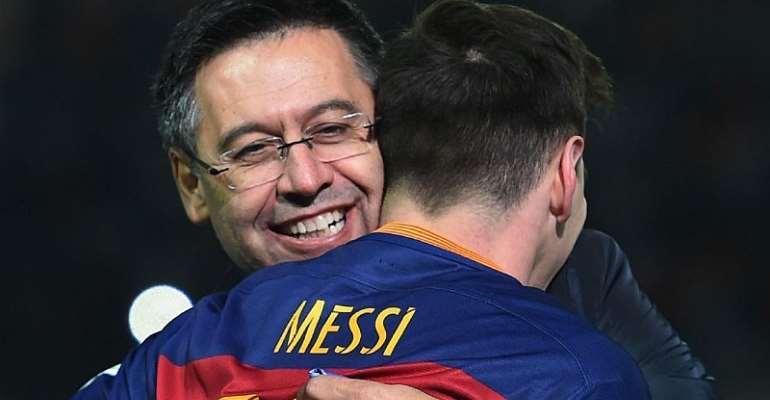 Josep Maria Bartomeu and Lionel Messi