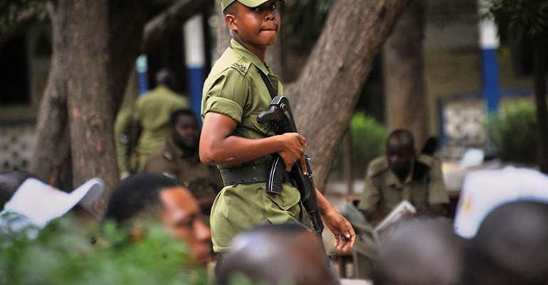 A Tanzanian police officer is seen in Dar es Salaam on October 28, 2015. Tanzanian authorities recently arrested Sebastian Atilio on false news charges. (AP/Khalfan Said)