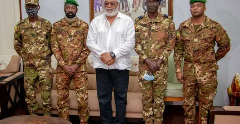 Flt. Lt. Rawlings in a group picture with Mali's Military Junta