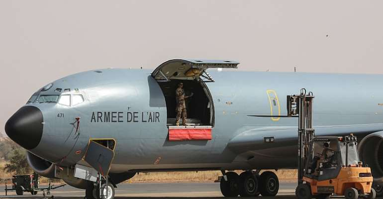 French Air Force soldiers work on a Boeing C135 parked on the French Air Force base in Niamey, Niger in December, 2017.  - Source: