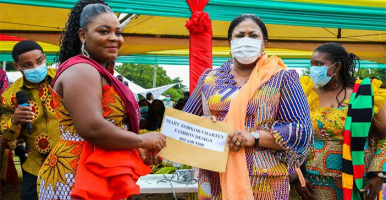Mary Korkor Chartey , a graduate receiving her start-up kit from First Lady, Mrs Rebecca Akufo-Addo.