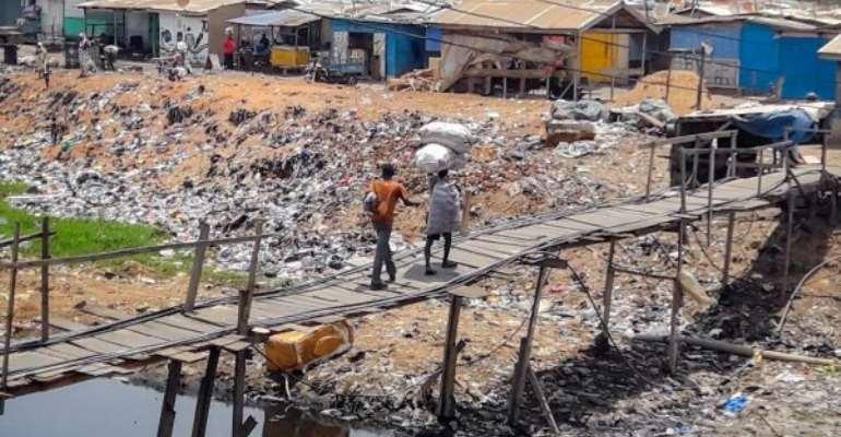 Slum Dwellers At Old Fadama Beg For Footbridge Over Agbogbloshie Drain