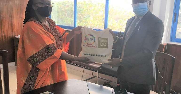 UNDP RR, Angela Lusigi, presenting a re-usable shopping bag to the EPA Director, Hon. Henry Kokofu