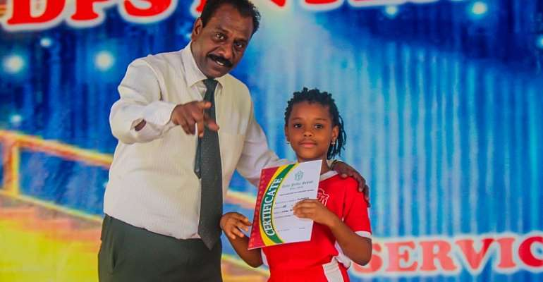 Mr David Raj, Headmaster Of DPS International (Ghana) With One Of The Winners Of The Recitation Competition
