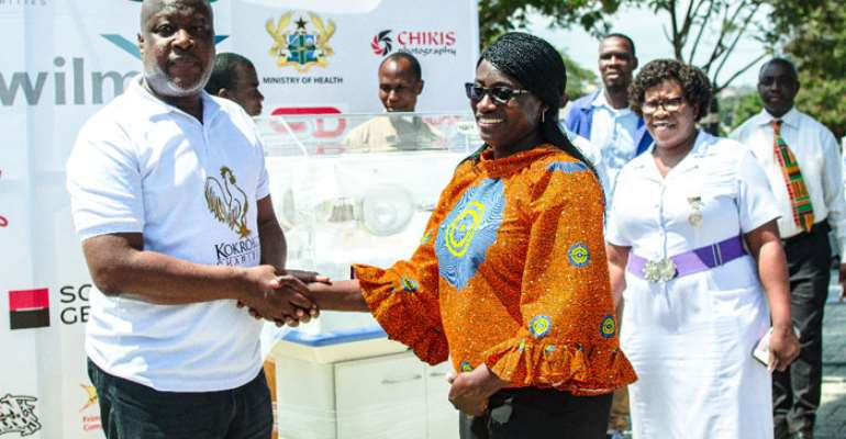 Kwame Sefa Kayi handing over the incubators to Dr. Audrey Frimpong-Barfi