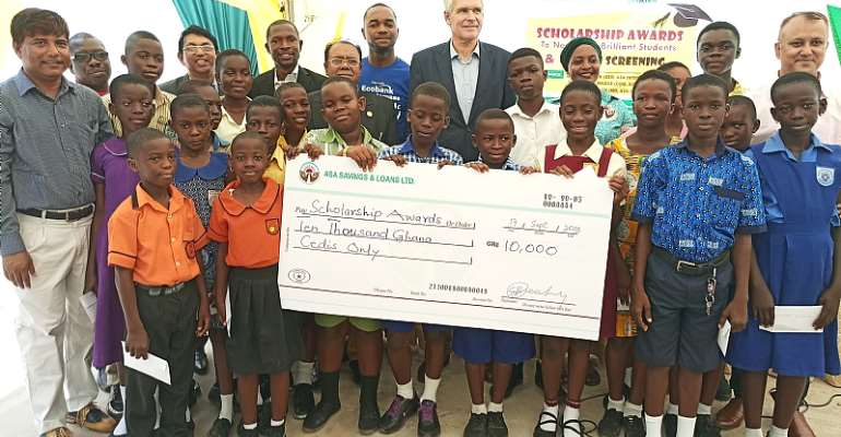 ASA Savings And Loans Presents Scholarship To 20 Students, Mosquito Nets To Clients