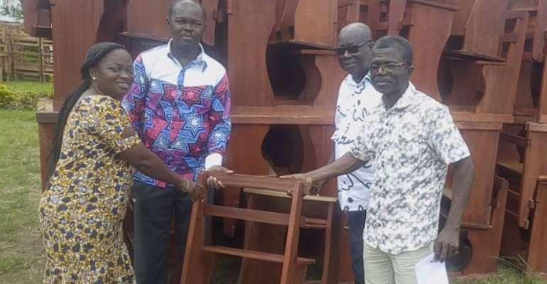 The DCE for AfrigyaKwabre North, Kwasi Karikari Acheamfuor, presenting the dual desks
