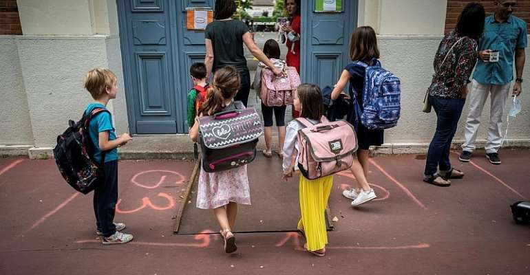 France eases Covid restrictions in primary schools despite rising cases