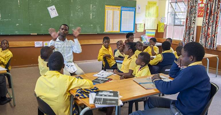 Deaf students learning sign language at a special school  - Source: