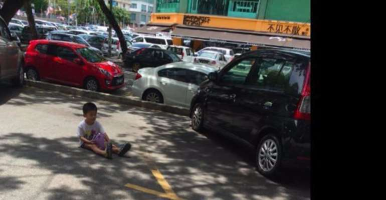 Mum forces toddler son to sit in parking to save her a spot