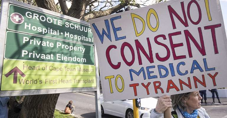 Civilians protesting  against COVID-19 vaccine mandates in Cape Town, South Africa. - Source: Brenton Geach/Gallo Images via Getty Images