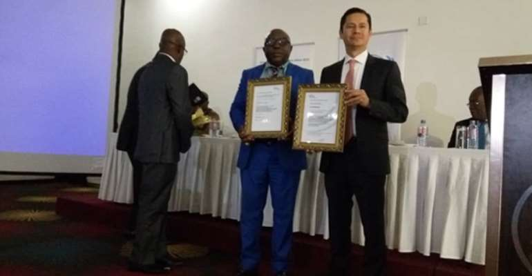 Mr. Kakari Addo (middle) displaying the certificates alongside UNIDO Project Manager, Pablo