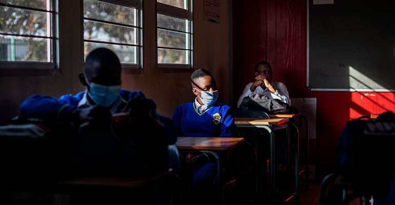 South Africa has to balance a number of factors when considering how to handle schools during the pandemic. - Source: MICHELE SPATARI/AFP via Getty Images