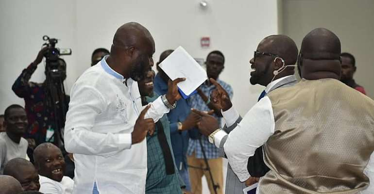 Healthy Rivalry As Two GFA Presidential Hopefuls Hug And Dance Together At Ghana Exim Bank