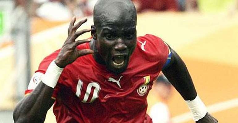 STEPHEN APPIAH CELEBRATES AGAINST USA AFTER SCORING A WINNING PENALTY
