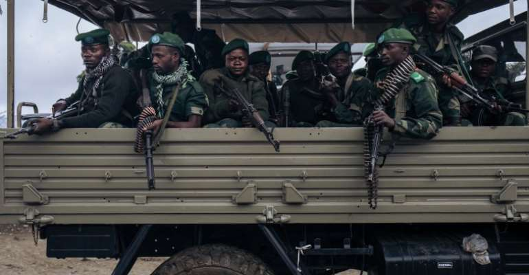 Soldiers are seen near Mutwanga, Democratic Republic of Congo, on May 24, 2021. Military officers recently detained journalist Pierre Sosthène Kambidi and are holding him without charge. (AFP/Alexis Huguet)