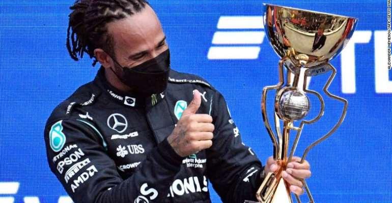 Hamilton celebrates on the podium after winning the Russian Grand Prix