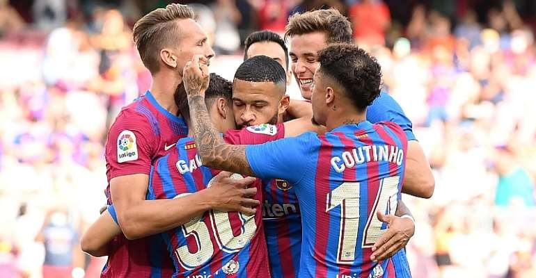 Memphis Depay of FC Barcelona celebrates after scoring their side's first goal with team mates during the LaLiga Santander match between FC Barcelona and Levante UD at Camp Nou on September 26, 2021 in Barcelona, Spain.  Image credit: Getty Images