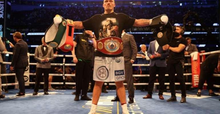 Oleksandr Usyk, the new IBF, WBA, WBO and IBO heavyweight world champion, celebrates with his belts after beating Anthony Joshua. Photograph: Mark Robinson/Matchroom Boxing