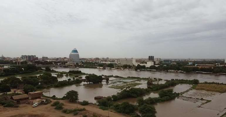A view of flooded farmland on the riverbank and swelling Blue Nile as its water level rises after heavy rainfall in Khartoum, Sudan  - Source: Photo by Mahmoud Hjaj/Anadolu Agency via Getty Images